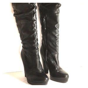 Jessica Simpson knee high black leather boots.